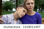 caring mother supporting teen... | Shutterstock . vector #1318011407