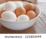 White And Brown Eggs In A Whit...