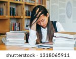 cute asian girl sitting in a... | Shutterstock . vector #1318065911