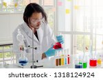 asian  scientist or chemist ... | Shutterstock . vector #1318124924
