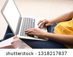 woman using laptop at home | Shutterstock . vector #1318217837