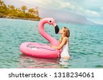 woman kissing toy flamingo in... | Shutterstock . vector #1318234061