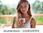 beautiful girl with morning tea ... | Shutterstock . vector #1318235591