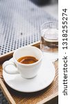 espresso is in the white cup.... | Shutterstock . vector #1318255274