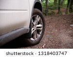 white suv car at forest trail... | Shutterstock . vector #1318403747