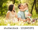 happy mother  father and... | Shutterstock . vector #131845391