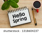 hello spring text in a notebook.   Shutterstock . vector #1318604237