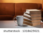 book and cup with a tasty drink. | Shutterstock . vector #1318625021