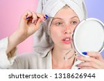 woman pulls out eyebrows with... | Shutterstock . vector #1318626944