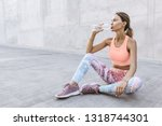 tired woman in sportswear... | Shutterstock . vector #1318744301