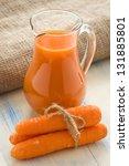 carrots juice in glass jug | Shutterstock . vector #131885801