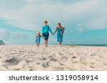 family with two kids walk on... | Shutterstock . vector #1319058914