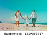 family with two kids walk on... | Shutterstock . vector #1319058917