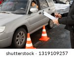 instructor conducting driver... | Shutterstock . vector #1319109257