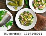 tasty herring salad with potato ...   Shutterstock . vector #1319148011