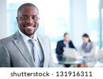 Stock photo image of african american business leader looking at camera in working environment 131916311