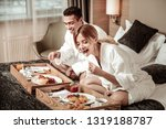 wife eating. blonde haired... | Shutterstock . vector #1319188787