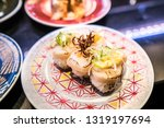 fresh sushi platter served in... | Shutterstock . vector #1319197694