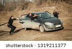 Small photo of Police agent and bodyguard training action gun shooting from car. Special agent team weapons training and course on outdoor shooting range