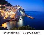 panorama view of Manarola village one of Cinque Terre at night in La Spezia, Italy - stock photo
