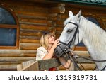 woman with a horse on a farm | Shutterstock . vector #1319319731