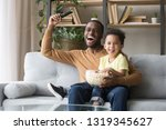 excited black father with... | Shutterstock . vector #1319345627