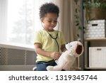 cute little toddler african... | Shutterstock . vector #1319345744