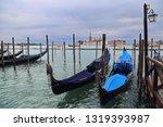 gondolas and the church of san... | Shutterstock . vector #1319393987