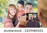 woman taking pictures of a... | Shutterstock . vector #1319484101