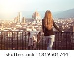 girl looking at the city of... | Shutterstock . vector #1319501744