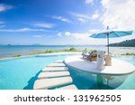beach chair with umbrella on... | Shutterstock . vector #131962505