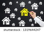 man drawing home icon on... | Shutterstock . vector #1319644247