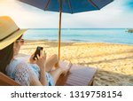 asian woman with hat sit on... | Shutterstock . vector #1319758154