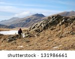 hiker on a high mountain field  ... | Shutterstock . vector #131986661