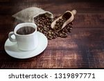 hot coffee cup and coffee beans ... | Shutterstock . vector #1319897771