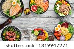 buddha bowl on a white wooden... | Shutterstock . vector #1319947271