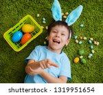 little boy in bunny ears are... | Shutterstock . vector #1319951654
