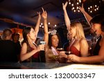 group of dancing female friends ... | Shutterstock . vector #1320003347