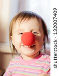 Kid With Red Nose Clown Foolin...
