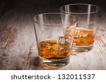 Two Glasses Of Whiskey Over...