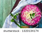 Stock photo traditional russian herring under a fur coat in transparent plate with parsley rustic style 1320134174