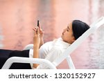 young woman touching on mobile... | Shutterstock . vector #1320152927