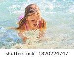 child blond girl enjoying ocean ...   Shutterstock . vector #1320224747
