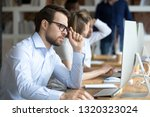 in coworking office working... | Shutterstock . vector #1320323024
