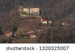 village kostel with medieval... | Shutterstock . vector #1320325007