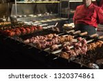 tasty grilled meat on skewers ... | Shutterstock . vector #1320374861