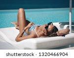 beautiful woman in black...   Shutterstock . vector #1320466904