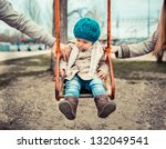 sad child on a swing  in... | Shutterstock . vector #132049541