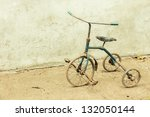 An Old And Rusty Tricycle