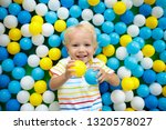 child playing in ball pit.... | Shutterstock . vector #1320578027